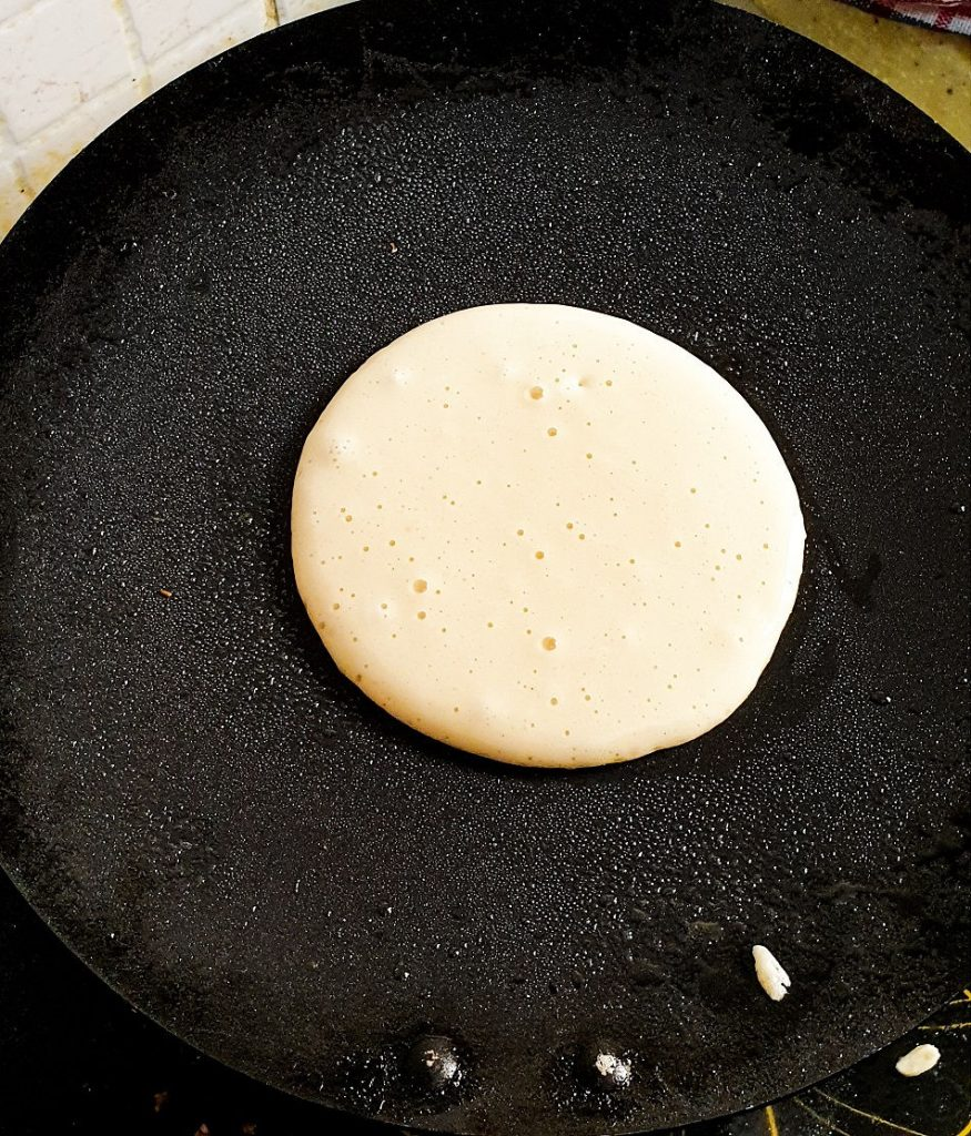pancake batter cooking on a pan