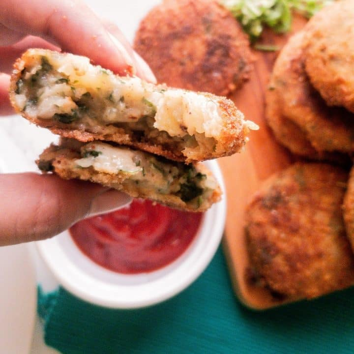 fried potato cakes with spinach and cheese with ketchup