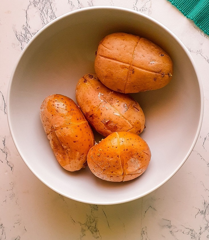 boiled potatoes in a white bowl