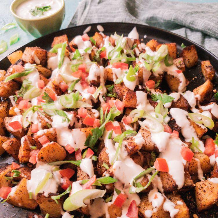 pakistani street food style batata harra on a black plate