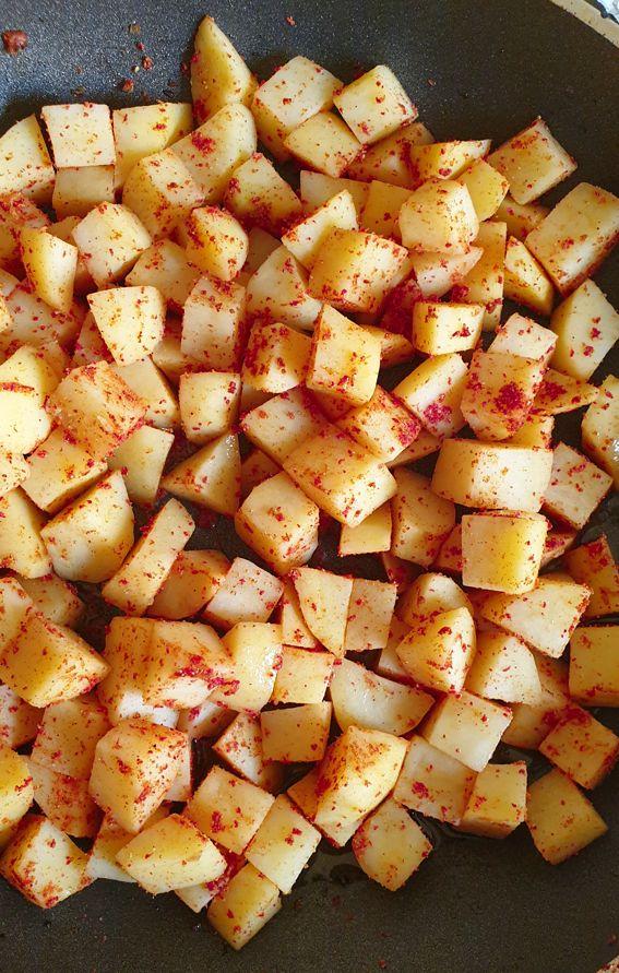 spiced batata harra on a frying pan