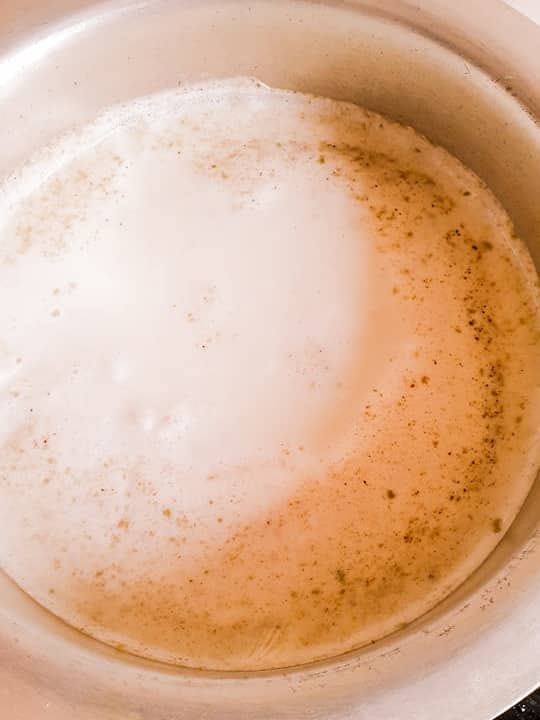 Milk boil in a wide cauldron