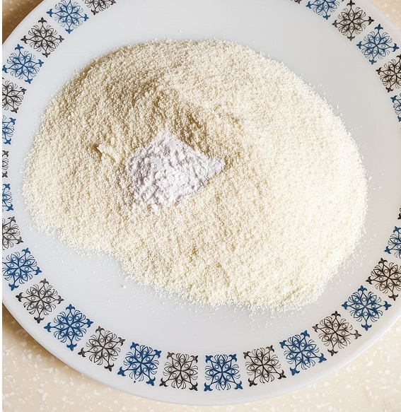 Dry ingredients for Rasmalai in a white plate