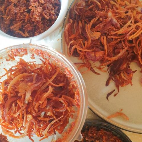 fried onions in a a nutribullet and some in a plate, and some fried onions already processed in a bowl.