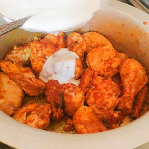 Adding yogurt in chicken ka salan