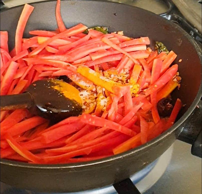 carrots in a wok for gajar ka achar
