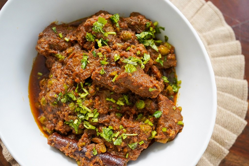 bhunna gosht or slow cooked beef in a white bowl