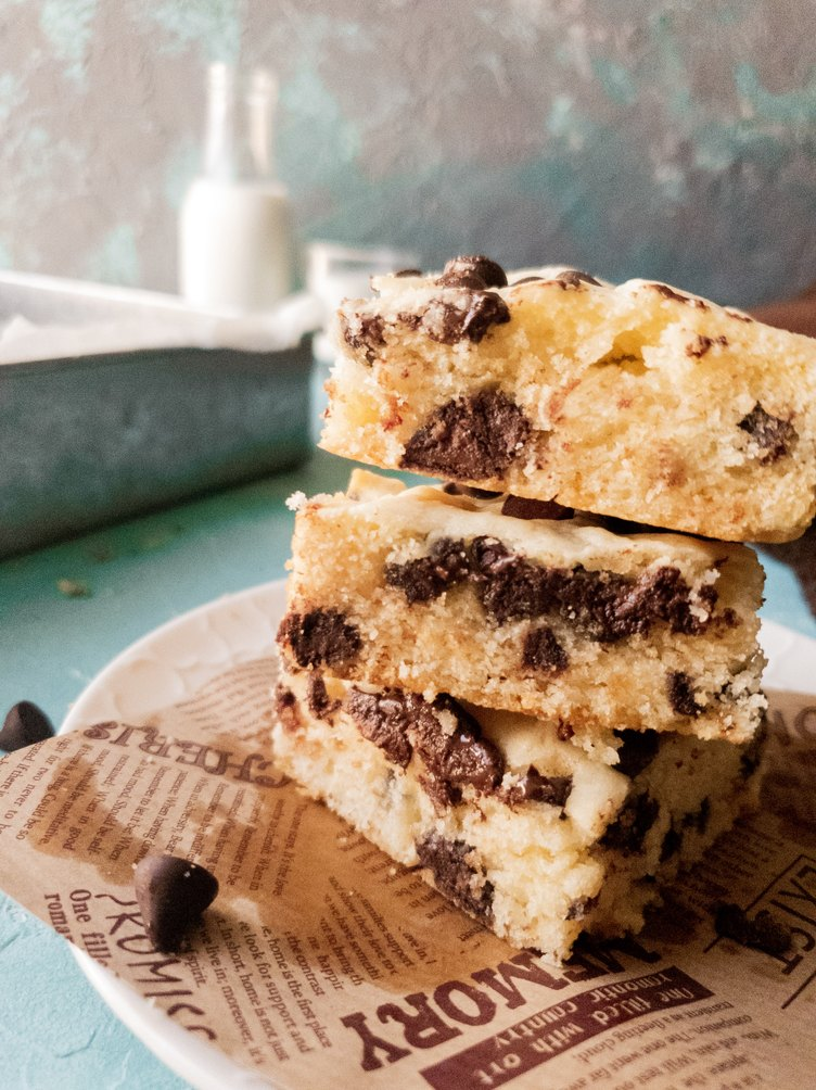 3 pieces of chocolate chip blonde brownies stacked on one another