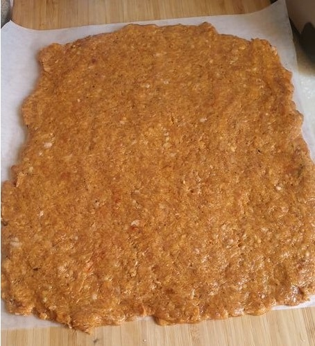 chicken nugget mix spread out in a thin layer on top of butterpaper
