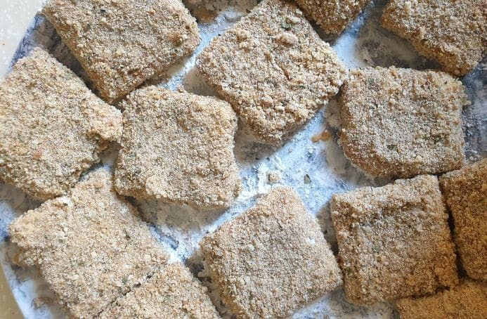 crumb coated tikka flavored chicken nuggets square cut in a plate