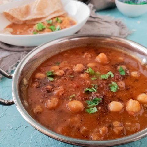 cholay kas salan or chickpea curry in a steal handi