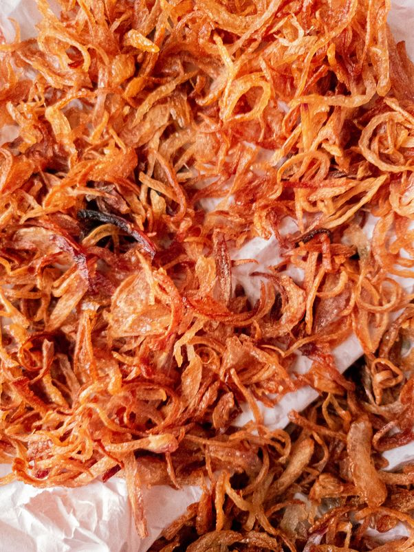 golden brown fried onions close up