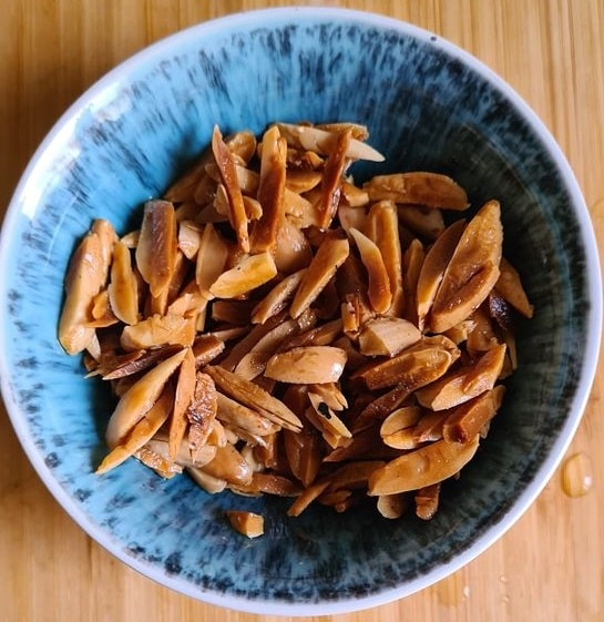 fried thin slivers of almond in a blue bowl