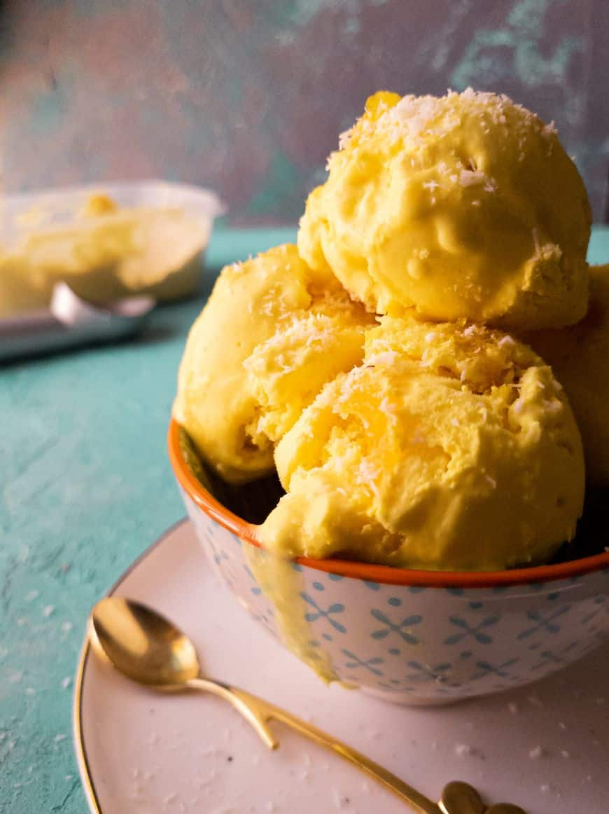 pineapple coconut ice cream scoops in a bowl