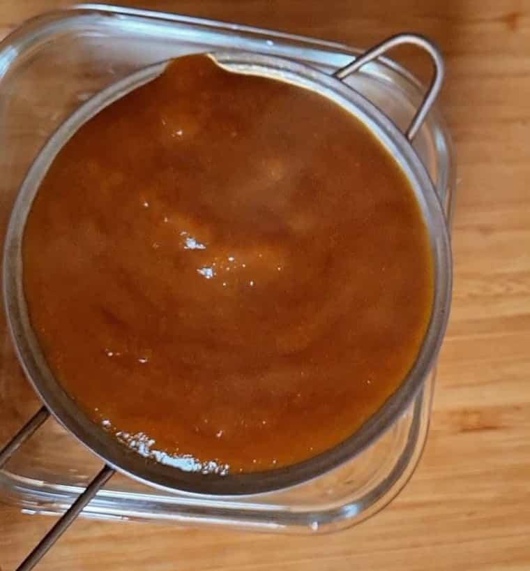 straining pineapple sauce
