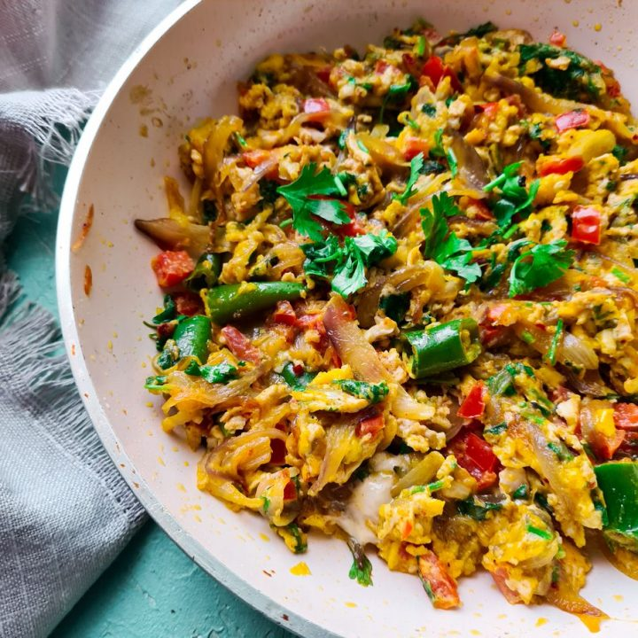 close up view of spicy scrambled eggs in a pan