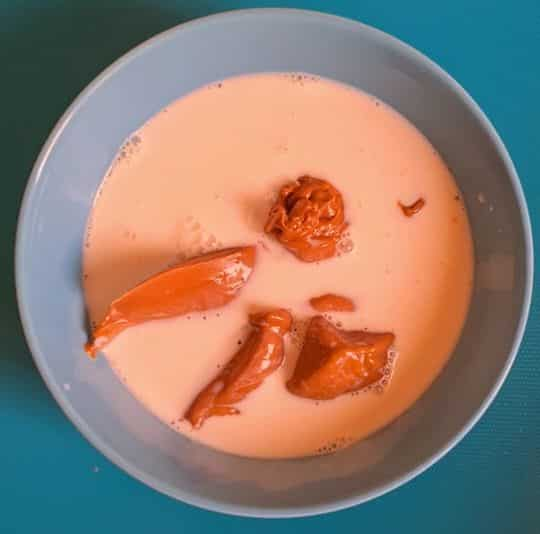 lotus biscoff spread in a bowl with milk in it (unmixed)