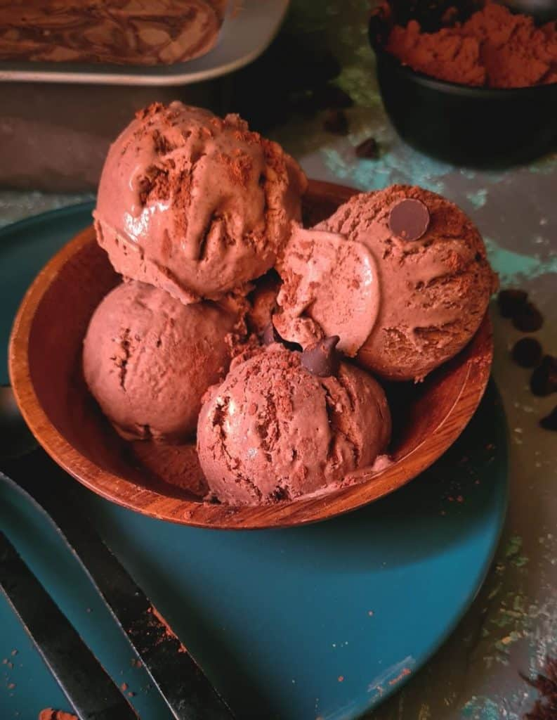 4 scoops of chocolate ice cream in a wooden bowl