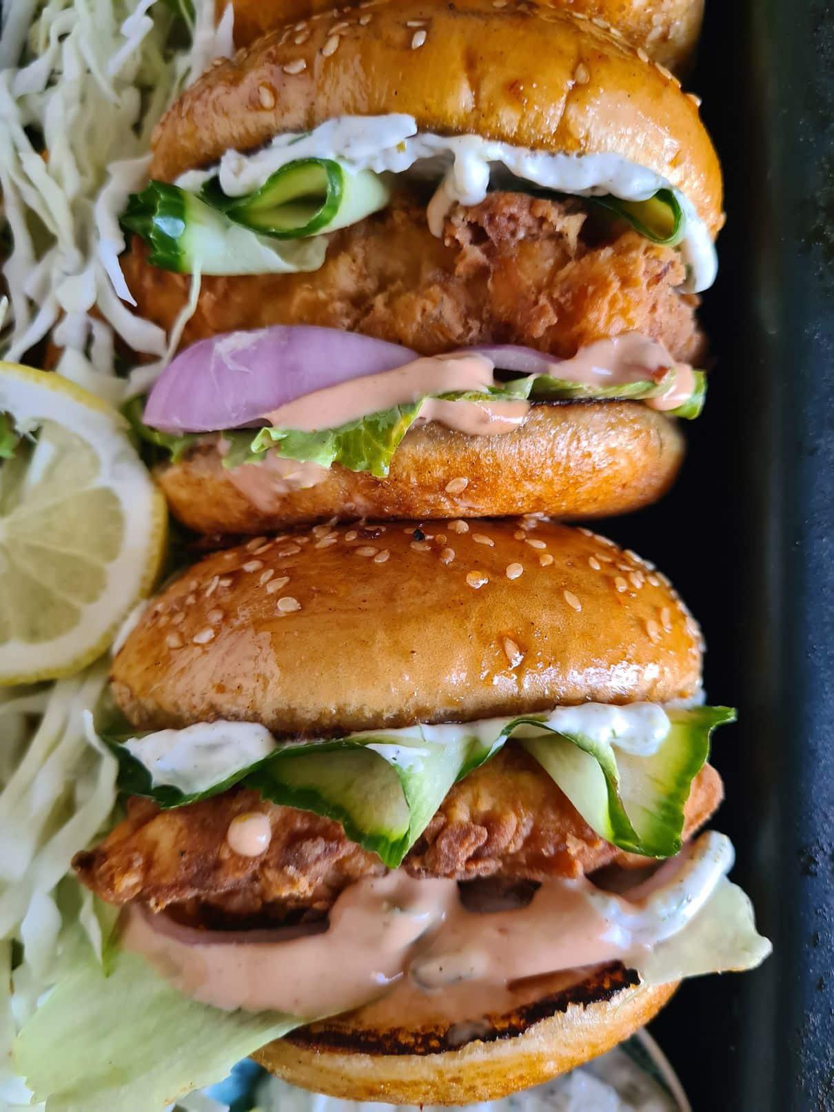 a close up of crispy fish burger