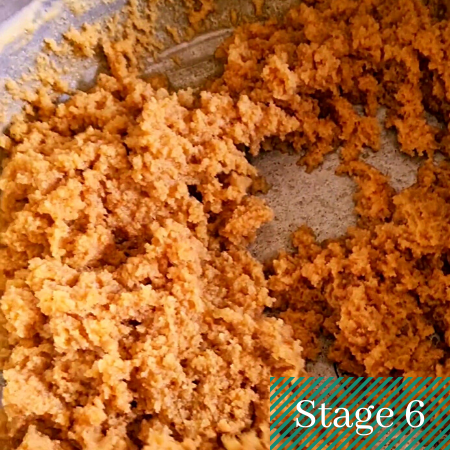 the halwa mix crumbly and brown in color in a pot