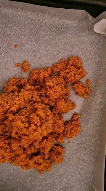 egg halwa crumbs on a piece of butter paper