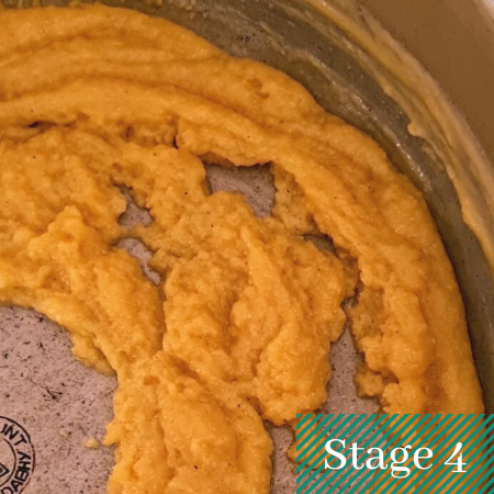slightly crumbly yellow halwa mix with a slight ghee separation.
