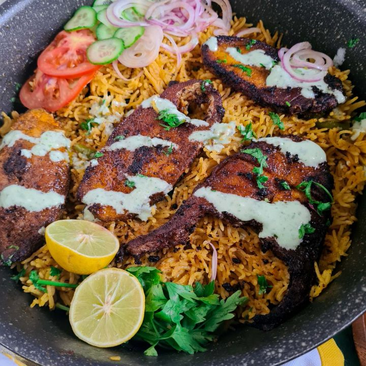 fish tahiri or tehri in a pot with salad and lemon