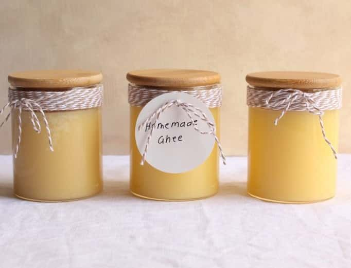 3 jars with yellow ghee in it.