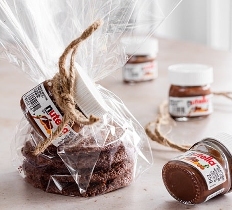 nutella cookies stacked and wrapped with a small nutella jar