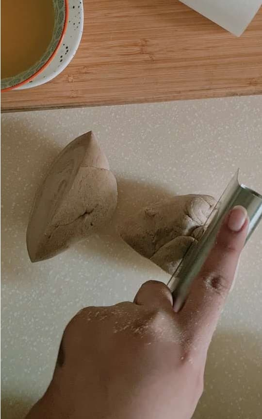 dividing kneading dough into smaller parts by a metal divider