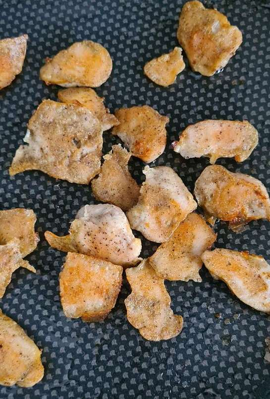 baked boneless chicken pieces on a baking tray