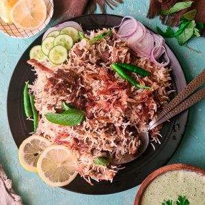 white mutton biryani made with goat meat in a black plate